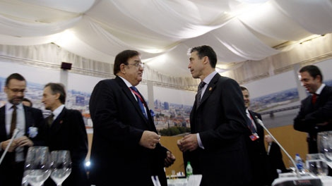 Afghanistan's Defense Minister Abdul Rahim Wardak, center left, shares a word with NATO Secretary General Anders Fogh Rasmussen during a meeting of NATO defence ministers in Bratislava, Slovakia, on Friday Oct. 23, 2009. (AP / Virginia Mayo)