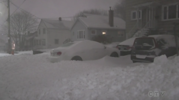 Punishing winter storm belts East Coast with heavy snow and high winds