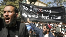 University students shout anti-U.S, NATO and Afghan government slogans during a demonstration in front of the Afghan Parliament in Kabul, Afghanistan on Sunday, Oct. 25, 2009. (AP / Musadeq Sadeq)