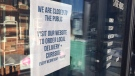 COVID-19 signs in storefronts in Barrie, Ont., on Sat., Feb. 6, 2021 (Steve Mansbridge/CTV News)