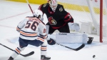 Edmonton Oilers right wing Kailer Yamamoto tries to put the puck past Ottawa Senators goaltender Matt Murray during second period NHL action Monday February 8, 2021 in Ottawa. THE CANADIAN PRESS/Adrian Wyld
