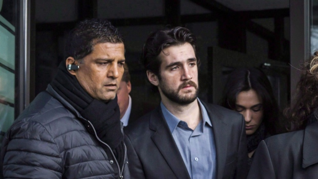 Marco Muzzo, centre, leaves the Newmarket courthouse surrounded by family members including his mother Dawn Muzzo, right, on February 4, 2016. A Toronto-area woman whose three children and father died in a horrific car crash says Muzzo, the drunk driver responsible, has been granted day parole. THE CANADIAN PRESS/ Christopher Katsarov