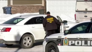 Members of the Winnipeg police conduct investigations and seizures in Winnipeg on Feb. 10, 2021. (CTV News Photo Ken Gabel)