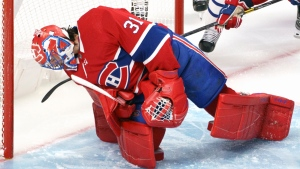 Montreal Canadiens goaltender Carey Price hangs on to the puck after making a save during second period NHL hockey action against the Toronto Maple Leafs in Montreal on Wednesday, February 10, 2021. THE CANADIAN PRESS/Paul Chiasson