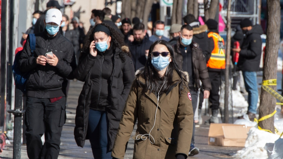 People make their way along St. Catherine street Wednesday, February 10, 2021 in Montreal.THE CANADIAN PRESS/Ryan Remiorz