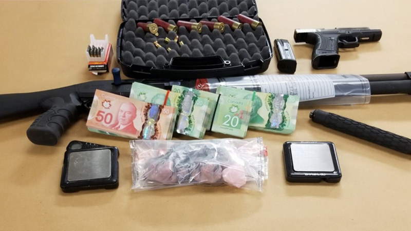 Guns, drugs and cash seized in London, Ont. on Wednesday, Feb. 10, 2021 are seen in this image released by the London Police Service.