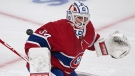 Montreal Canadiens goaltender Jake Allen makes a save against the Calgary Flames during second period NHL hockey action in Montreal, Saturday, January 30, 2021.THE CANADIAN PRESS/Graham Hughes