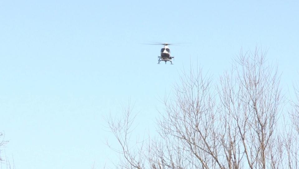 An OPP helicopter flies over Espanola