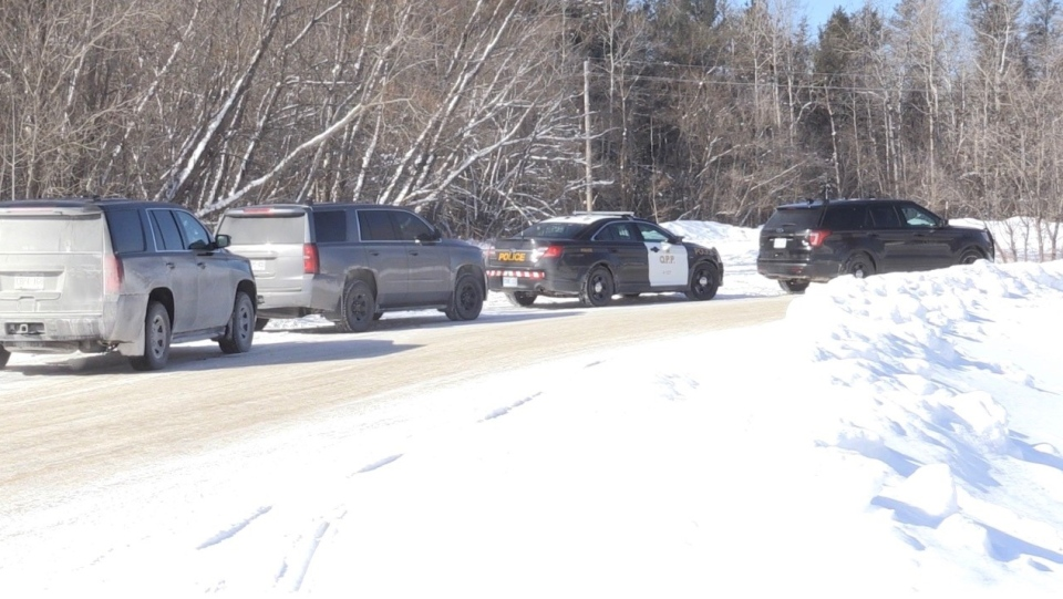 Several police vehicles in Espanola in winter
