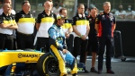 Renault's Spanish driver Fernando Alonso sits on the wheel of his Renault R25 car ahead of his demonstration laps prior to the Abu Dhabi Formula One Grand Prix in the Yas Marina racetrack in Abu Dhabi, United Arab Emirates, Sunday, Dec.13, 2020. (Brynn Lennon, Pool via AP)