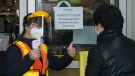 A person get the thumbs up after getting their temperature tested at the T&T grocery store to help curb to spread of COVID-19 in Markham, Ont., on Monday, April 20, 2020. THE CANADIAN PRESS/Nathan Denette