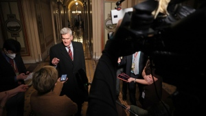 Sen. Bill Cassidy, R-La., talks with reporters as he leaves the U.S. Capitol after the first day of Trump's second impeachment trial in the Senate, on Feb. 9, 2021. (Chip Somodevilla / Pool via AP)