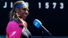Serena Williams waves as she is interviewed after winning her fourth round match against Aryna Sabalenka of Belarus at the Australian Open tennis championship in Melbourne, Australia, Sunday, Feb. 14, 2021.(AP Photo/Hamish Blair)
