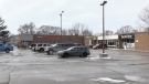 A person was found unresponsive in a vehicle parked in this lot on Charles Street West in Ingersoll, Ont. as seen Monday, Feb. 15, 2021. (Jim Knight / CTV News)