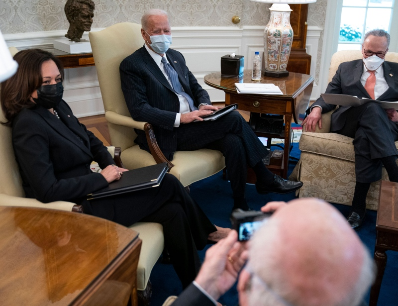 U.S. Vice President Kamala Harris, President Joe Biden and Senate Majority Leader Chuck Schumer meet to discuss a coronavirus relief package in the Oval Office of the White House on Wednesday, Feb. 3, 2021. (AP Photo/Evan Vucci)