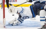 Winnipeg Jets goalie Connor Hellebuyck (37) is scored on by the Edmonton Oilers during second period NHL action in Edmonton on Monday, February 15, 2021. THE CANADIAN PRESS/Jason Franson