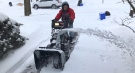 Al Smith clears a neighbour's driveway in London, Ont. on Tuesday, Feb. 16, 2021. (Sean Irvine / CTV News)
