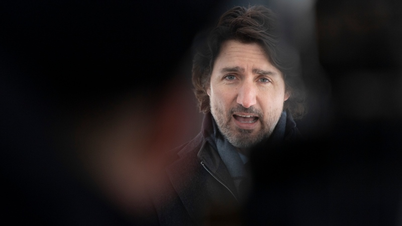 Prime Minister Justin Trudeau delivers opening remarks before taking questions from the media outside Rideau Cottage Ottawa, Tuesday, February 9, 2021. THE CANADIAN PRESS/Adrian Wyld