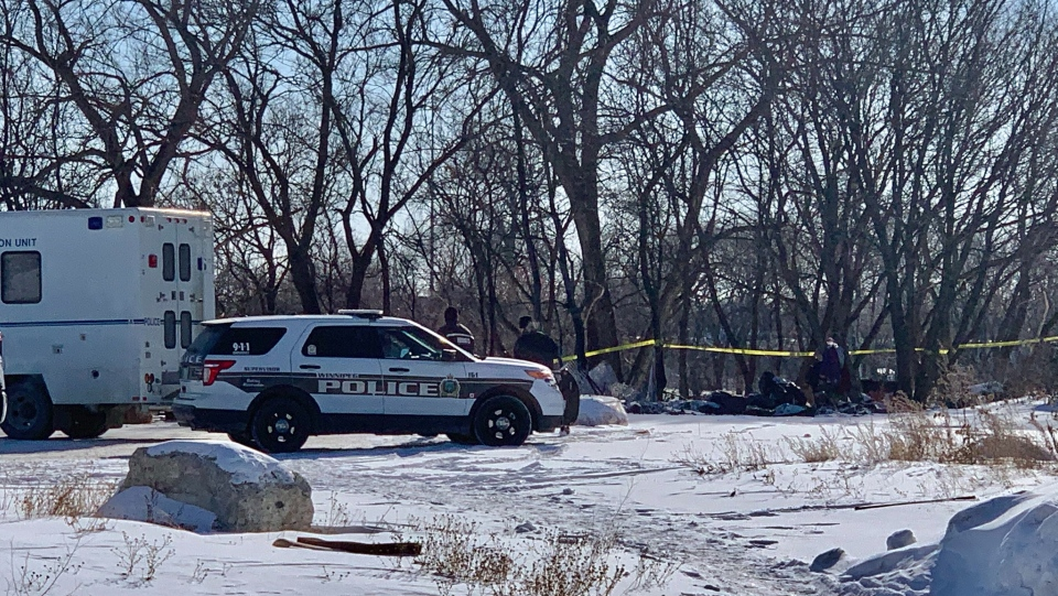 Winnipeg police on the scene of a fatal fire at a temporary encampment in the first 100 block of Higgins Avenue in Winnipeg on Feb. 16, 2021. (Source: Scott Andersson/ CTV News Winnipeg)