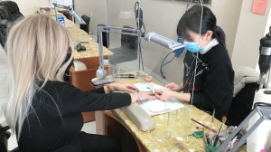 A woman gets her nails done as stores reopen in the red zone in Barrie, Ont. on Feb 16, 2021. (Aileen Doyle/CTV News)