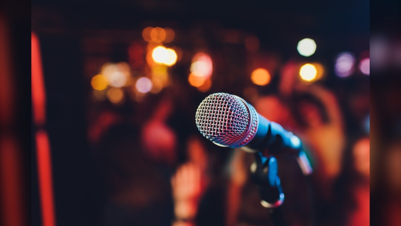 A karaoke microphone on a stage seen in this file photo.