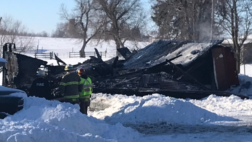 Wilmot Township crews put out hot spots at a garage fire on Snyder's Road near Baden. (Chris Thomson/CTV Kitchener) (Feb. 17, 2021)