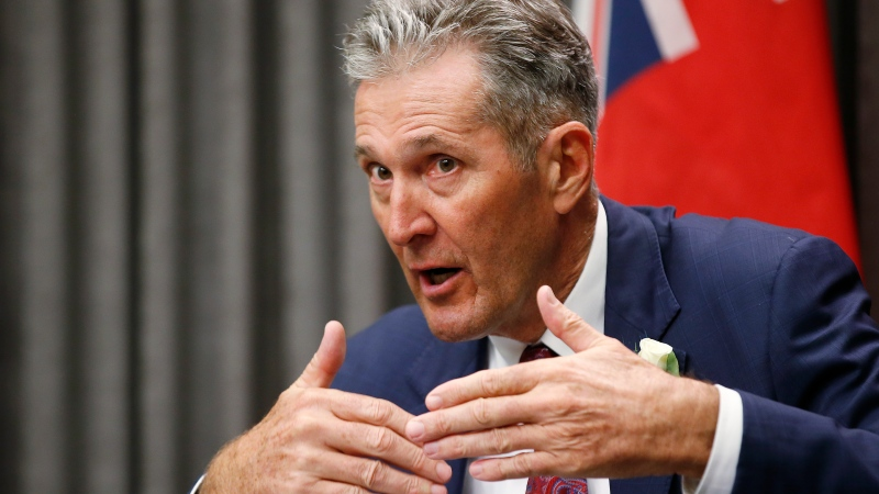 Manitoba premier Brian Pallister speaks to media prior to the reading of the Speech from the Throne at the Manitoba Legislature in Winnipeg, Wednesday, October 7, 2020. THE CANADIAN PRESS/John Woods