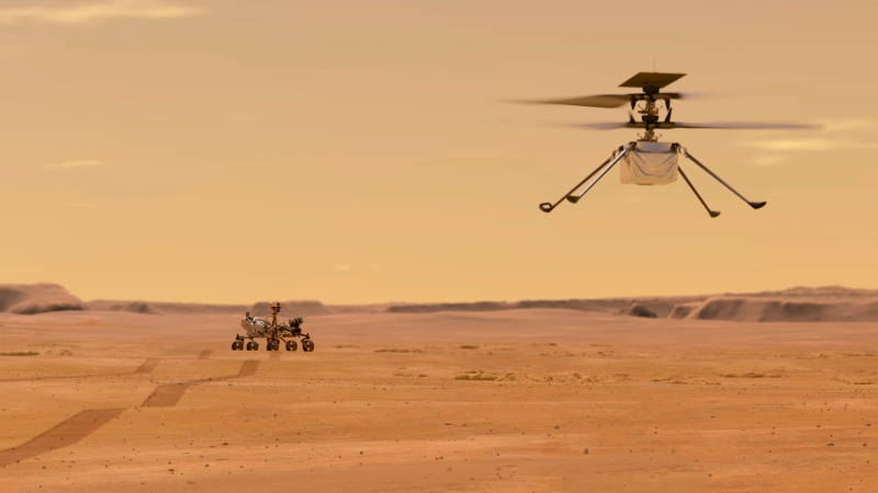 This illustration made available by NASA depicts the Ingenuity helicopter on Mars after launching from the Perseverance rover, background left. (NASA/JPL-Caltech via AP)