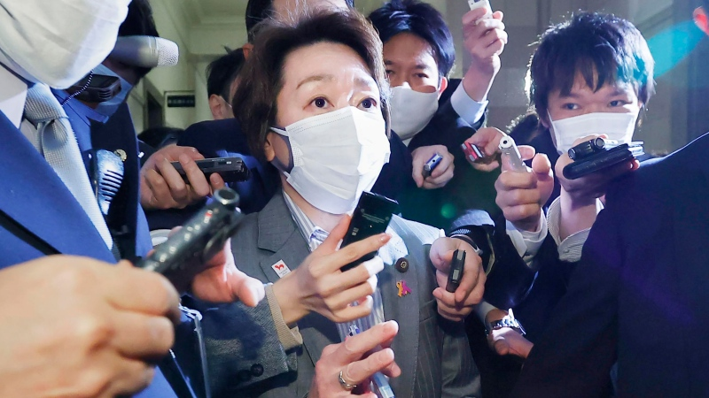Japan's Olympics Minister Seiko Hashimoto, centre, is surrounded by reporters at the Lower House in Tokyo, Wednesday, Feb. 17, 2021. (Meika Fujio/Kyodo News via AP)
