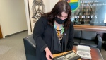 Treaty Commissioner Mary Culbertson reviews material from the newly-opened archive.  (Nicole Di Donato/CTV News)