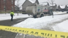 A waste collection truck seen on a Kitchener street on Feb. 18, 2021 after a crash involving a pedestrian. (Dan Lauckner / CTV Kitchener)