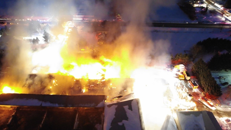 This aerial photo shows a fire at a dairy farm near Aylmer, Ont. on Wednesday, Feb. 17, 2021. (Source: Malahide Fire Service)