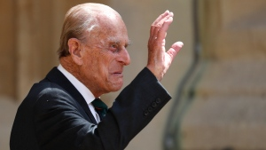 FILE - In this Wednesday July 22, 2020 file photo, Britain's Prince Philip arrives for a ceremony for the transfer of the Colonel-in-Chief of the Rifles from himself to Camilla, Duchess of Cornwall, at Windsor Castle, England. (Adrian Dennis/Pool via AP, File)