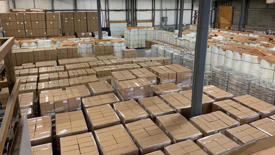 Boxes of masks at a Cambridge facility