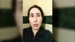 This undated image taken from video in an unknown location shows Sheikha Latifa bint Mohammed Al Maktoum speaking into a mobile phone camera. The United Nations' human rights body said Wednesday Feb. 17, 2021, it will seek information from the United Arab Emirates about the daughter of Dubai's powerful ruler after she said in video messages that she was being imprisoned in a heavily guarded villa. (#FreeLatifa campaign – Tiina Jauhiainen/David Haigh via AP)