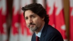 Prime Minister Justin Trudeau listens to question during a news conference in Ottawa, Friday, Feb. 19, 2021. THE CANADIAN PRESS/Adrian Wyld