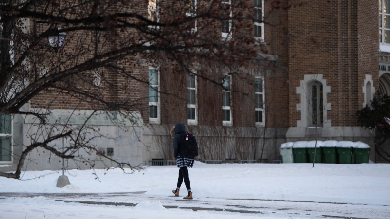 A student arrives at a high school in Ontario, as in-person classes resume in the region for the first time since the winter holidays, on Monday, Feb. 1, 2021, in the midst of the COVID-19 pandemic. (Justin Tang/The Canadian Press)
