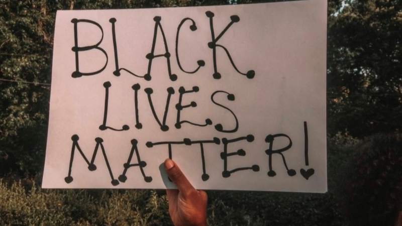 A person holds a Black Lives Matter sign. (Courtesy: Selam Debs)