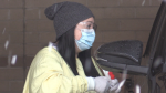 A nurse at the RVH COVID-19 testing centre holds a swab test in Barrie, Ont. (CTV News Barrie)