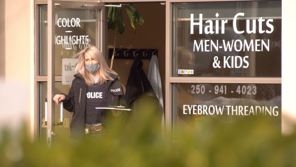 An RCMP officer is seen leaving another business in the same complex where the incident took place: Feb. 19, 2021 (CTV News)
