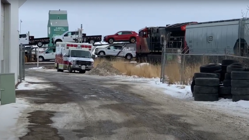A still from this video by Mitchell Parker shows a CN train moments before it clips the back of a semi trailer in Parkland County on Feb. 19, 2021.