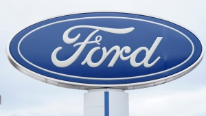 In this Sunday, Dec. 20, 2020, file photo, the company logo is viewed on a sign outside a Ford dealership, in Centennial, Colo. (AP Photo/David Zalubowski, File)