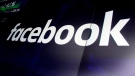 FILE - In this March 29, 2018 file photo, the logo for Facebook appears on screens at the Nasdaq MarketSite, in New York's Times Square. (AP Photo/Richard Drew, File)