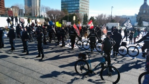 Edmonton Police Service members at the Alberta Legislature before two groups met to hold rallies on the grounds on Feb. 20. (Amanda Anderson/CTV News Edmonton)
