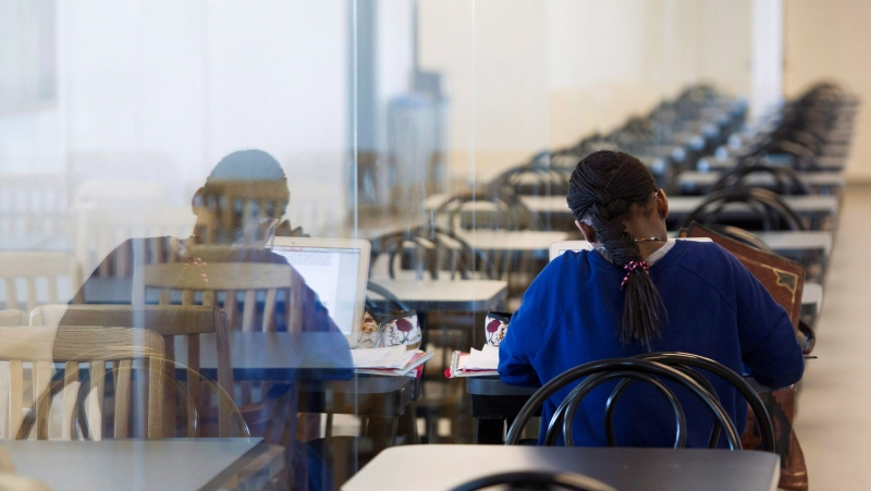 A young woman studies at the College de Maisonneuve in Montreal, Sunday, March 13, 2016 (file photo). THE CANADIAN PRESS/Graham Hughes