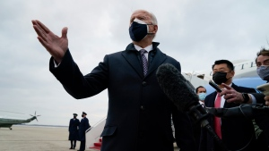 U.S. President Joe Biden speaks to member of the media after exiting Air Force One, Friday, Feb. 19, 2021, in Andrews Air Force Base, Md. (AP Photo/Evan Vucci)