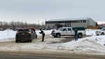 People at GraceLife Church's gate on Sunday, Feb. 21, 2021, eventually began telling incomers to watch the livestreamed service from their vehicles in the parking lot because the building had reached fire code capacity.