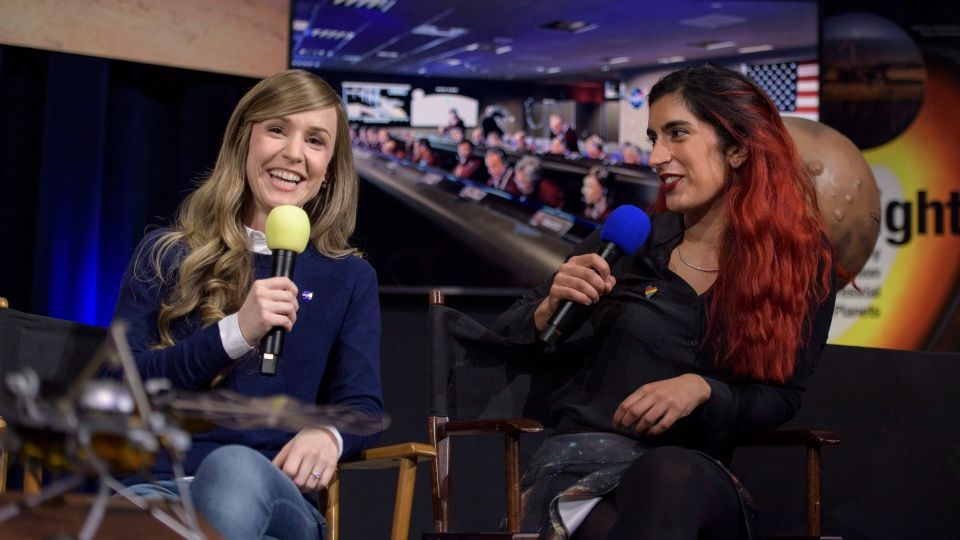 Aline Zimmer, left, EDL systems engineer with NASA's Jet Propulsion Laboratory, and Farah Alibay, payload systems engineer, talk during a social media briefing at JPL in Pasadena, Calif., on November 25, 2018. THE CANADIAN PRESS/AP - HO, NASA - Bill Ingalls