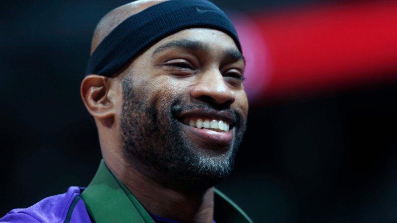 FILE - In this Oct. 21, 2017, file photo, then-Sacramento Kings guard Vince Carter smiles in the first half of an NBA basketball game, in Denver. Carter, the oldest active player in the NBA, is about to begin his 21st season and first with the Atlanta Hawks, a rebuilding team that's likely to be among the worst in the league. (AP Photo/David Zalubowski, File)