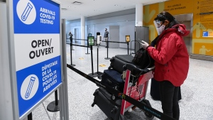 Shiromali Krishnaraj arrives from India and is directed to take a mandatory COVID-19 test at Pearson International Airport during the COVID-19 pandemic in Toronto on Monday, February 1, 2021. THE CANADIAN PRESS/Nathan Denette